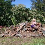 Young child sits over a crater in Hawaii