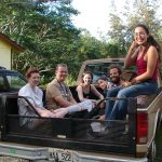 Early Hedonisian volunteers hitch a ride