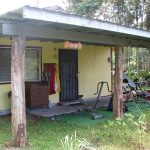 The lanai - front porch - at Jungle Cottage