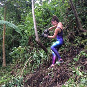 Woman clearing bush in Hawaii