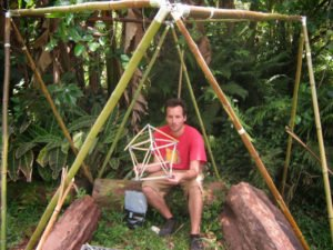 Hedonisia volunteer displays his geometric creation