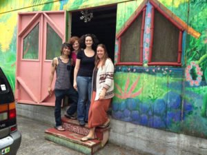Community members pose in front of Hedonisia's Yoga Barn