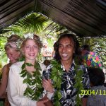 Mojo and Leah walking down the isle in their jungle wedding